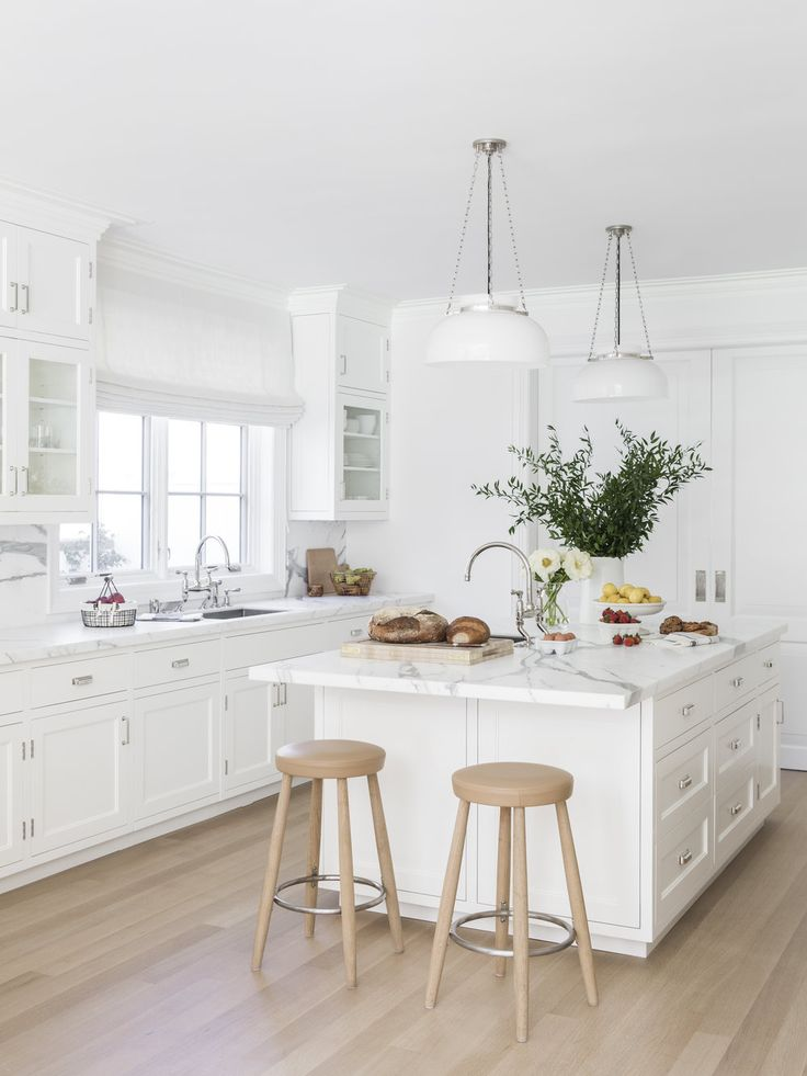 all white kitchen design with marble countertops kapito muller