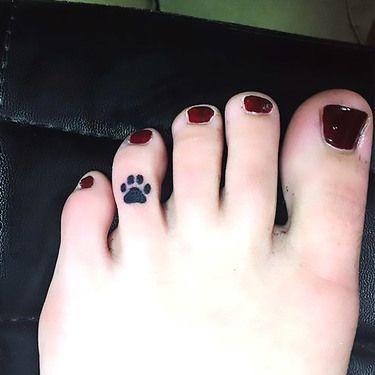 Tiny Paw Print on Toe Tattoo Idea