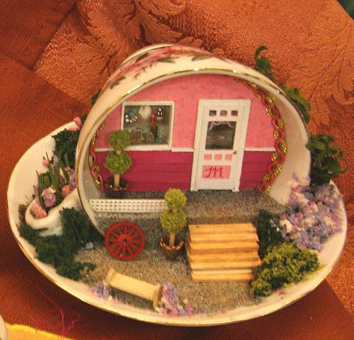 Quarter Scale (1:48) front porch scene in a tea cup by Mary Johnson