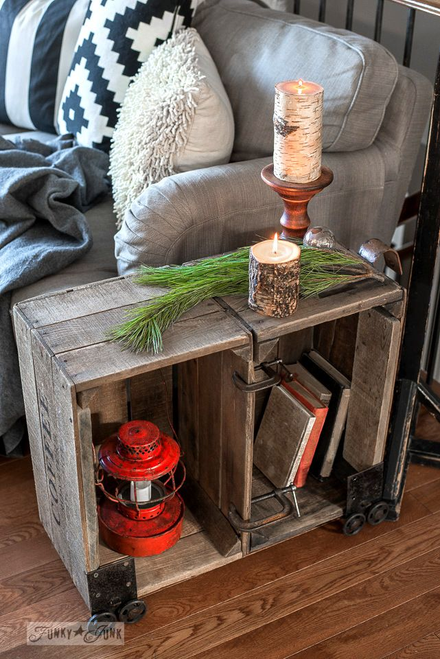 Double coffee crate side table with industrial faux wheels and bark candles, beside a snowflake winter pillow, part of Funky Junk's Christmas home tour. See it all at funkyjunkinteriors.net #christmas
