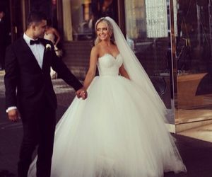 I love her princess wedding dress. If it is possible for a wedding dress to be both dramatic yet simple all at once, this one wins :)
