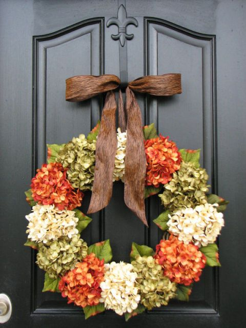 Artificial red and white hydrangeas offer a fuller, more complete look to the classic wreath shape.  $120, etsy.com