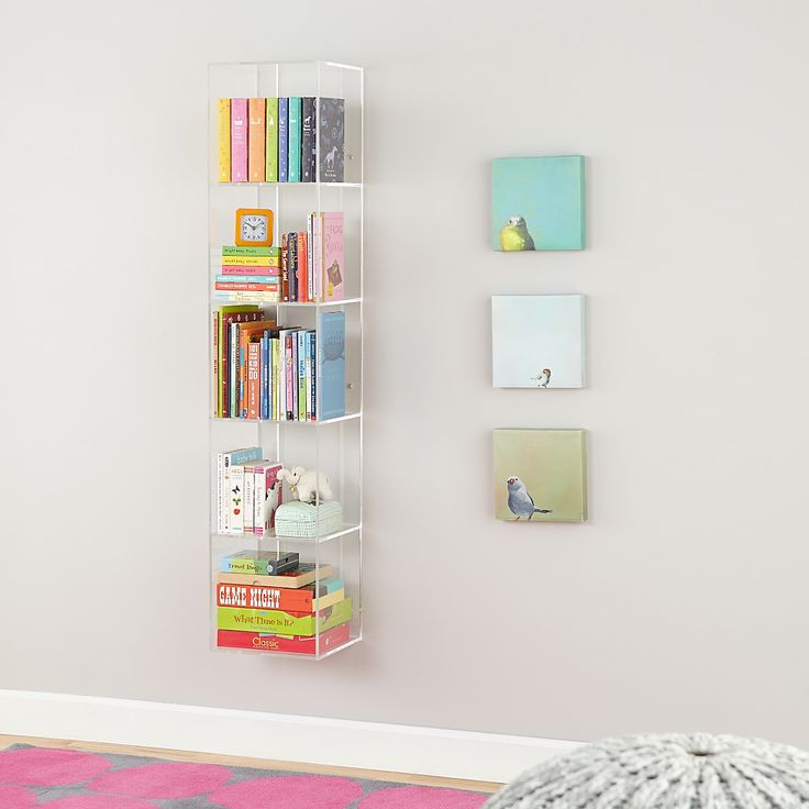 For our next trick, we're going to make your bookshelf disappear. Well, not really, but we will allow you to replace it with this modern, seamless bookcase. The clear, acrylic construction makes your books appear as if they're floating.
