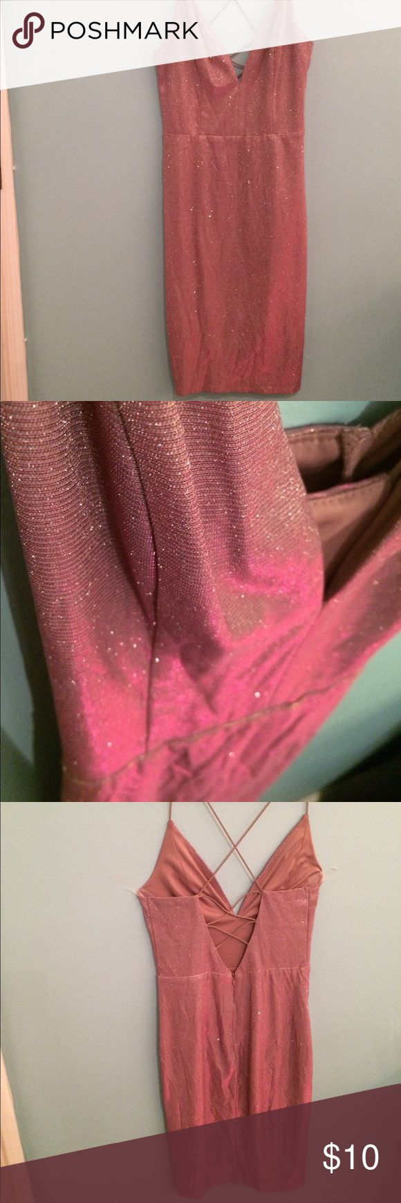 Iridescent pinkish/light purple Sparkly dress! Iridescent dress, has sparkles but they don't rub off! Light weight material, Form to the body, laces up in the back and cuts down in the front. Very pretty! Worn only once. Charlotte  Ruse, beautiful find. Short and fun party dress! Charlotte Russe Dresses Mini