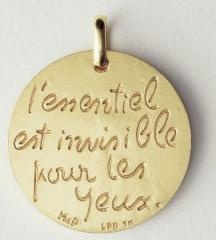 """Love this Medallion with my favorite quote from The Little Prince. """"one sees clearly only with the heart, everything essential is invisible to the eyes."""""""