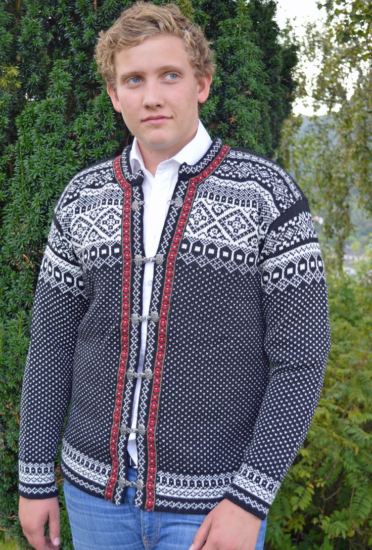 Rundemann cardigan - the iconic, classic Norwegian cardigan - knitted in 100% wool with pewter hooks and wool braiding. The rich intricate design is inspired by the patterns used in the Setesdal area of Norway - arguably the most traditional and well known patterns being used in Nordic sweaters. Sizes S-XXL. Available in two colour combinations as well as a sweater version. Made in Norway