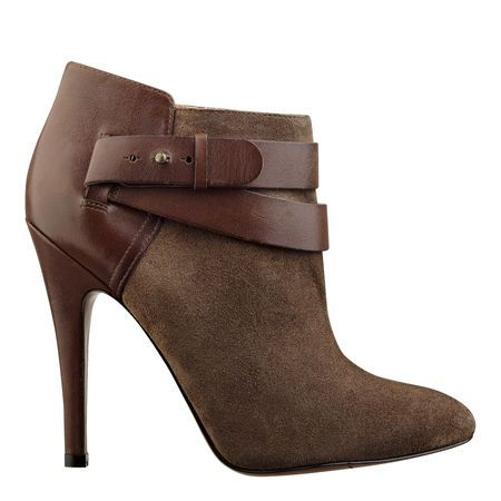 "As seen in the September issue of People Style Watch.....Almond toe single sole 4.5"" bootie with contrast belt detail.  Side zipper closure.  Leather upper."