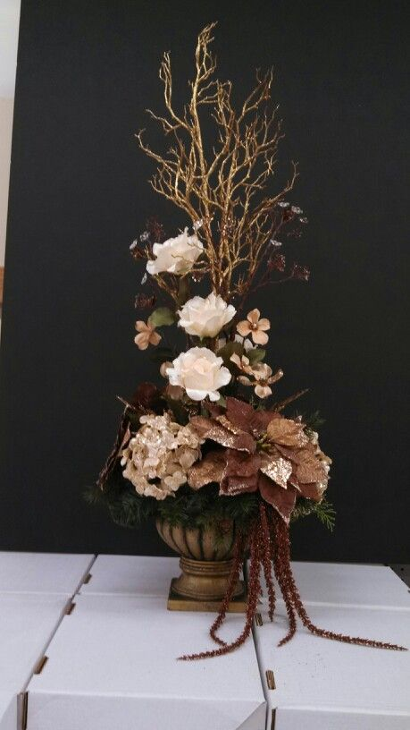 cream and chocolate Christmas floral arrangement that Michael