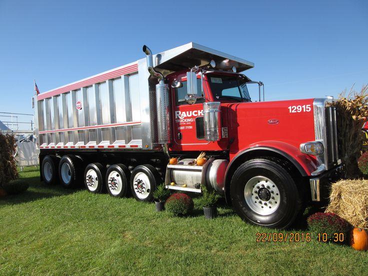 Long big red 6 axle Peterbilt dump truck