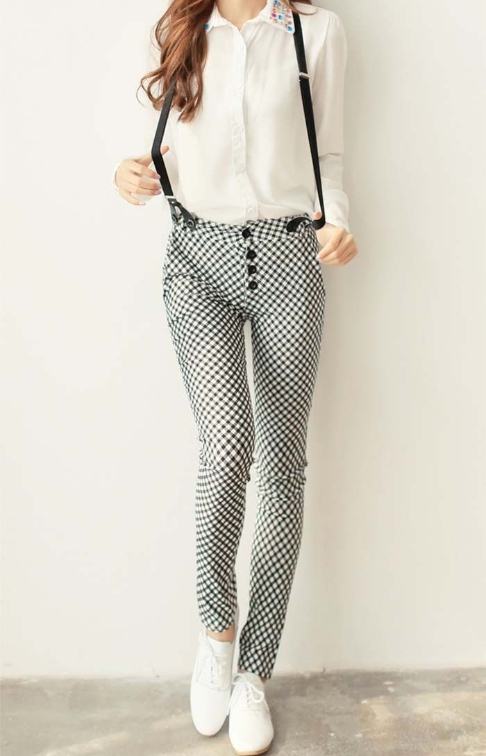 Sharp black braces accent these Checked patterned trousers and white button-down shirt #chic