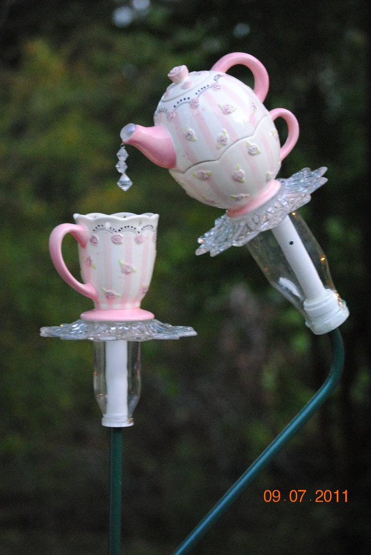 Upcycled garden yard art. Pieces of used pottery and glass and beads glued together, then put on a metal rod to make yard art.