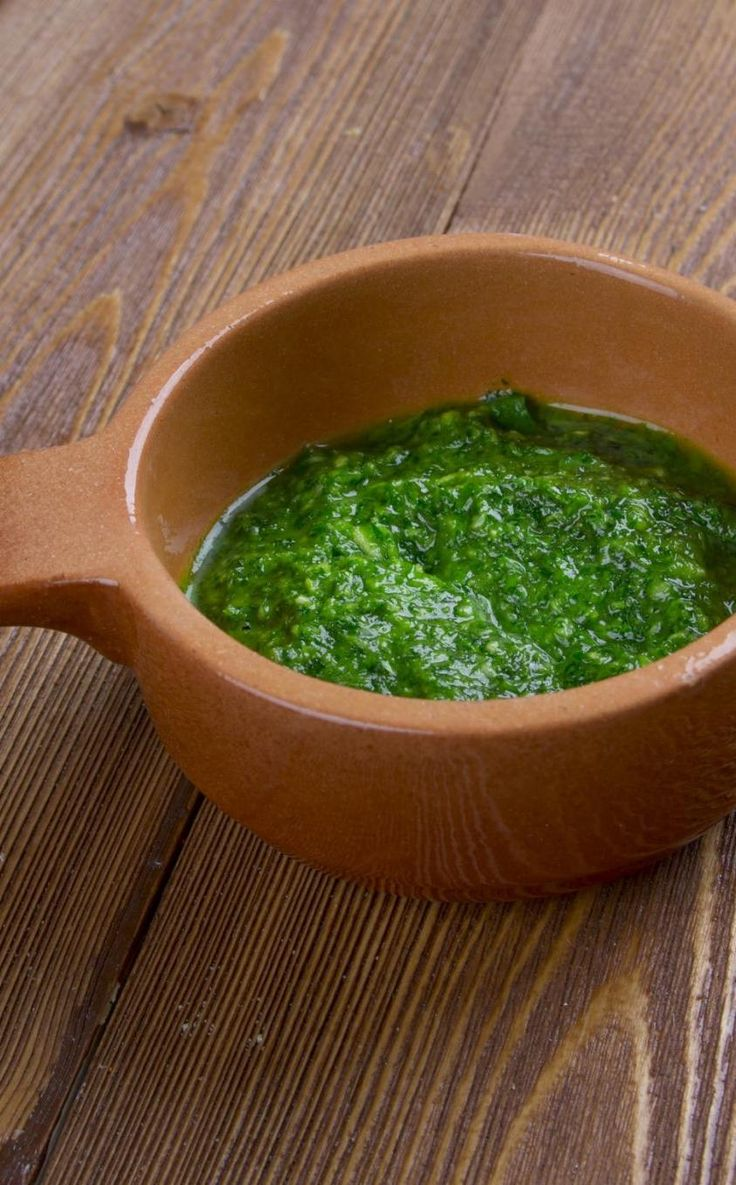 Z'hug, or schug, is the Yemenite version of hot sauce. It is very popular in Israeli dishes, especially on top ofshawarmaorfalafel, and even insoup!There are several varieties, including red, green, and brown. This green version is rich with cilantro, parsley, andjalapeñopeppers.