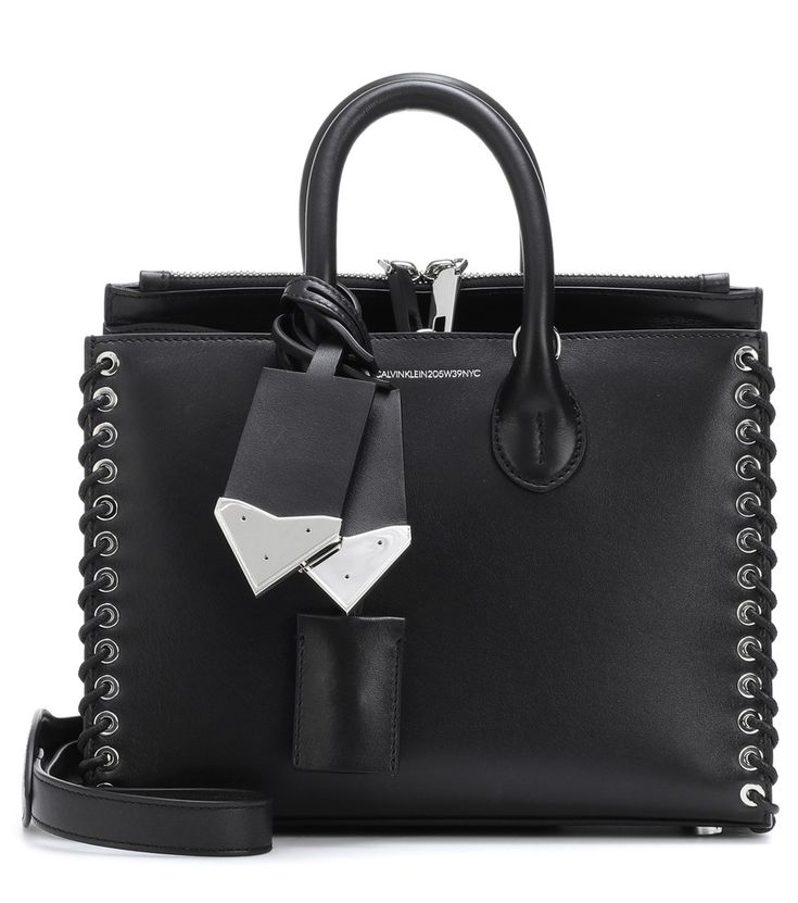 Calvin Klein 205W39NYC - Small Whipstitch leather tote - Raf Simons introduces a chic and conceptual design with this structured tote from CALVIN KLEIN 205W39NYC. Crafted from smooth leather in classic black, it comes with edgy silver-tone hardware – including a padlock and hanging tags, as well as grommets along the whip-stitched edges. Make yours a day-to-day accessory, working it with anything and everything. seen @ www.mytheresa.com