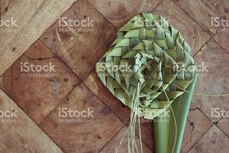 Putiputi woven from flax on a sunbleached wooden table royalty-free stock photo