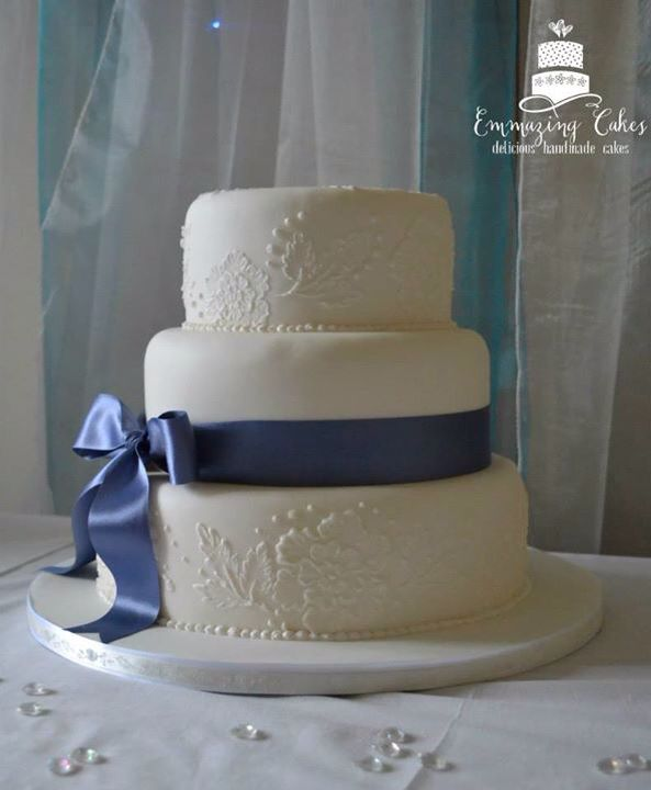 Elegant wedding cake with brush embroidery detail and large silk bow. More at www.facebook.com/emmazingcakes