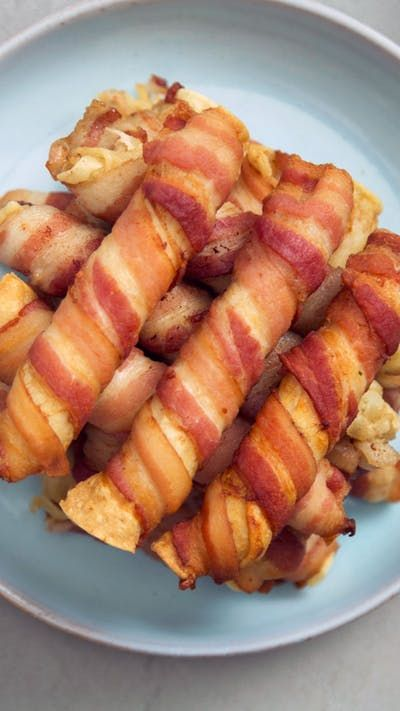 Recipe with video instructions: Ordinary chicken taquitos are fine, but an extra wrapping of bacon is like trying them again, for the first time. Ingredients: 1/4 cup ranch seasoning, 1 cup sour cream, 1 rotisserie chicken, shredded (about 3 cups), 2 poun