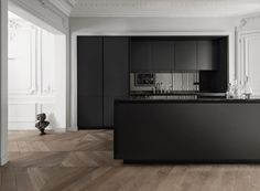 """SieMatic PURE / S2: A realm of contrasts is created by the owners of this generous apartment in an older building in the heart of Paris. Their idea: """"When black meets white; classic meets modern, and master craftsmanship meets perfect industrial processing, the result is interior design that could not be more exciting."""""""