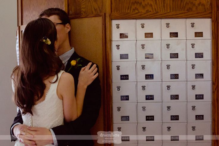 Post office kissing photo of the bride and groom at the St. Paul's School in Concord, NH before their wedding ceremony.  #postofficekiss #spswedding #dreamlovephotography