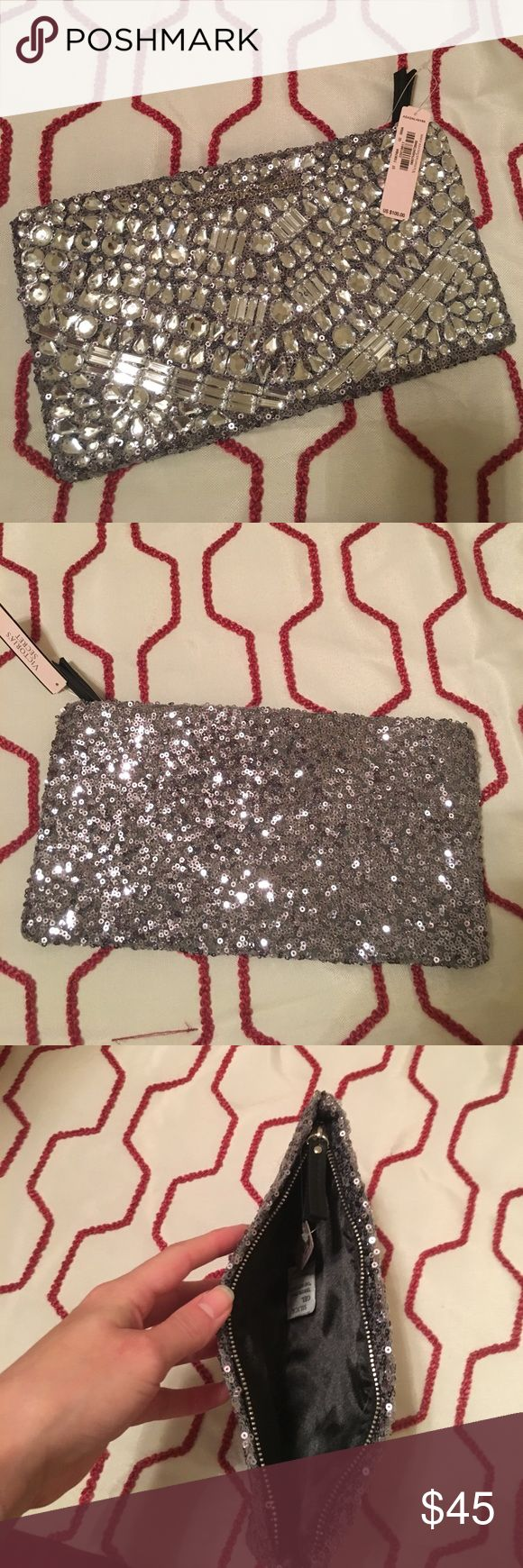 NWT Silver Sequined & Jeweled Beaded Clutch Statement clutch! NWT Victoria's Secret silver sequined and beaded with silver jewels. Black zipper with black satin interior.  ⭐️Bundle for Discounts⭐️  🌺15% off 2+ Items! 🌺 Victoria's Secret Bags