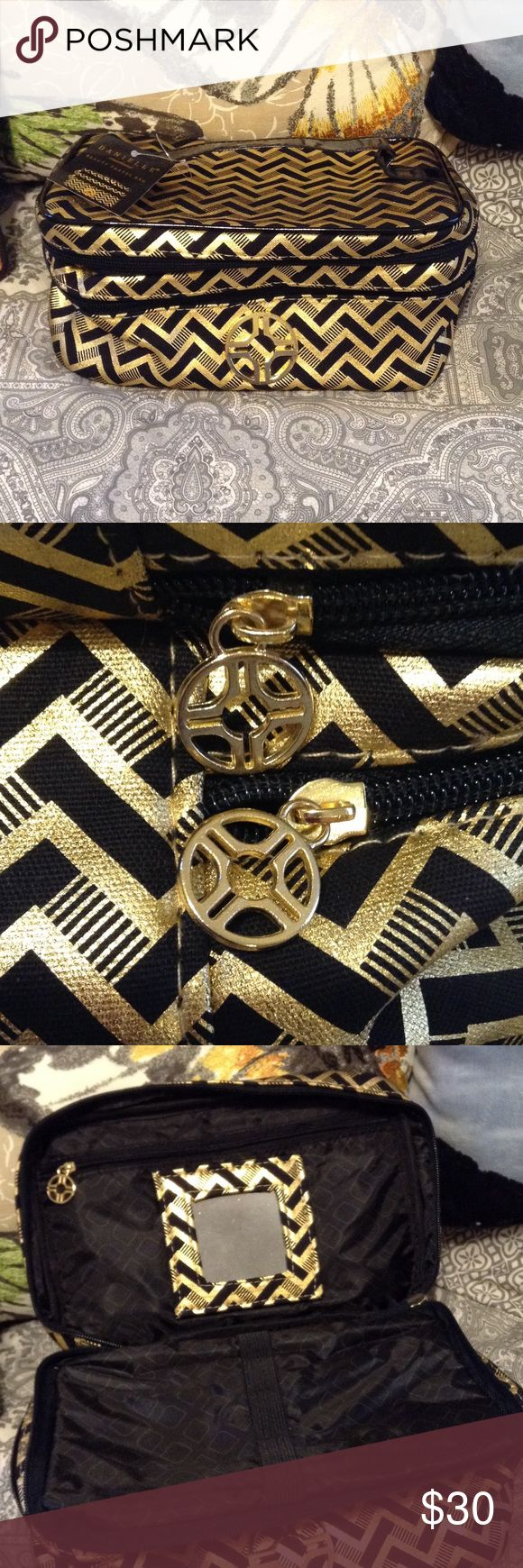 🆕💄Make-Up, Jewelry, Etc. Bag 💍🕶👙 NWT! Black and Gold Zigzag Print Beauty Travel Bag. Double Compartment. Top has a Zippered Pocket, Removable Mirror, and Elastic Band to Hold Brushes, Combs, etc. Bottom is one big compartment. Black Handle Across Top. Danielle Brand Danielle Bags