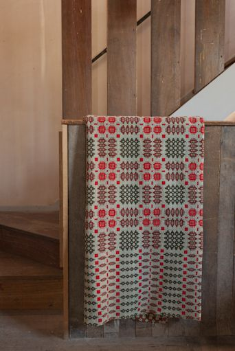 A hand woven original welsh blanket. This rug is reversible revealing a complimentary design. Retrouvius Reclamation and Design