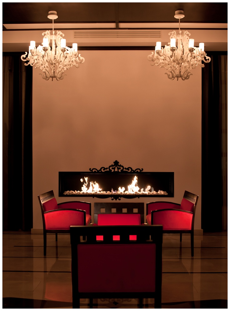 A good book and a cup of wine are the perfect companions in Epoque lounge  #fireplace #design