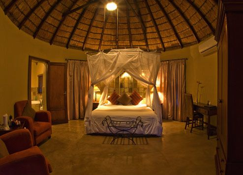Bedroom under thatch at Elephant Plains Game Reserve. http://www.pridelodges.com/index.php/game-lodges/classic/elephant-plains/