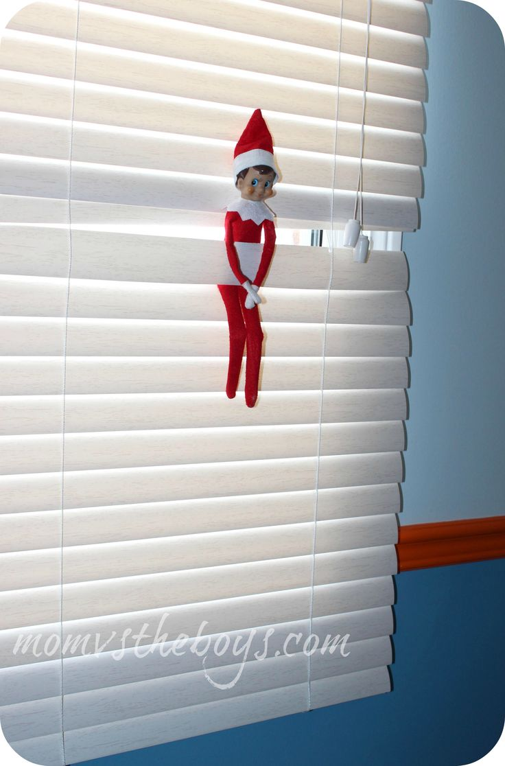 Elf on the Shelf ideas - in the window...oh TWO now! :))))) in my cheap blinds...ha