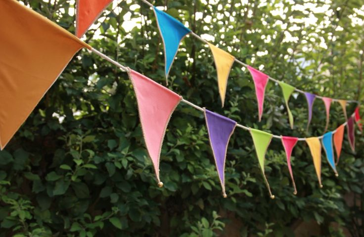 colourful party event hire bunting with tiny bells that ring in the wind @fireflyworkshop