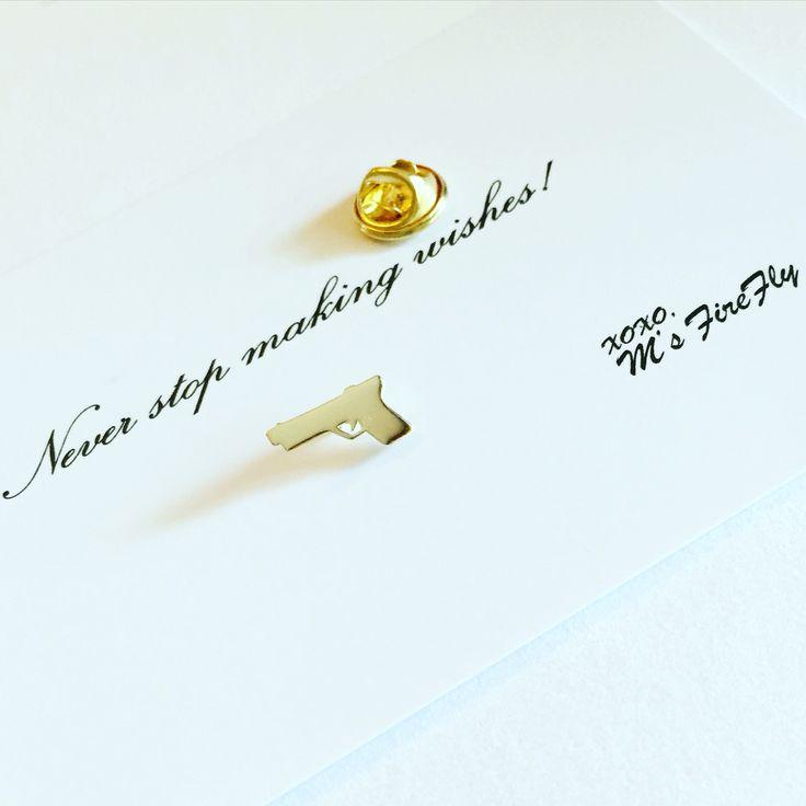 Gold lapel pin