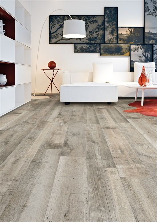 Worn look grey wood floors look like they could have come off a farmhouse barn.