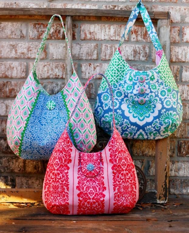 Ruby Bag Sewing Pattern by artsycraftybabe     Sometimes I just can't wait to post a pattern.  I spied this bag and my mouse started clicking and my hands starting flapping lol!  Although this bag appears very simple, the shape is beautiful and the fabrics chosen here are just heavenly…
