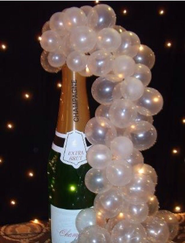 Inflatable Champagne bottle with clear to balloons to give the champagne bubbles effect