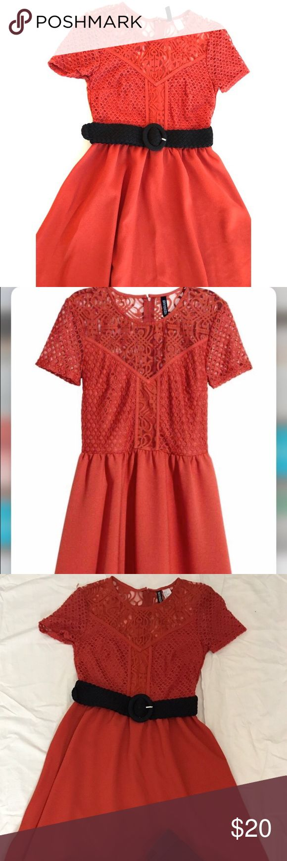 H&M orange lace dress Super cute rustic orange sundress. Lace style fitted top and flowy skirt. Zips up the back and a perfect dress for a dark waist belt. Divided Dresses