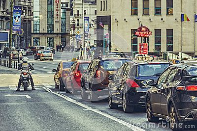 Bucharest, Romania - March 16, 2014: Rush hour, traffic jam on Victory Avenue (Calea Victoriei), a major avenue in central Bucharest city.