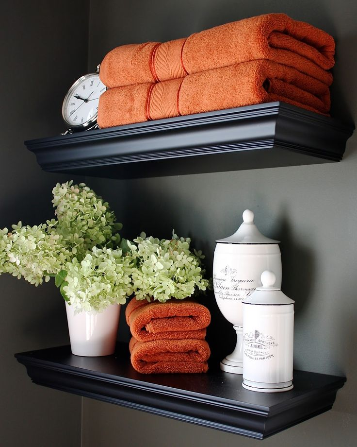 powder room shelves with bright orange towels- perfect for fall.
