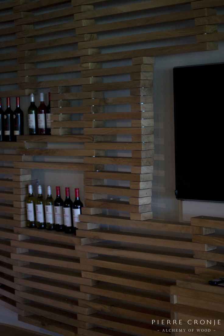 A wine display unit at Leopards Leap in Franschhoek, South Africa. Interior design by Christiaan Barnard, solid wood furnishings and shopfitting by Pierre Cronje
