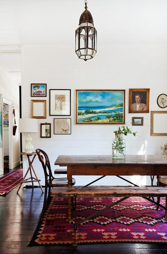 Living Room Gallery Wall With Rustic Dining Table And Benches Mix Of Art Work Kilim Rug Vintage Chandelier