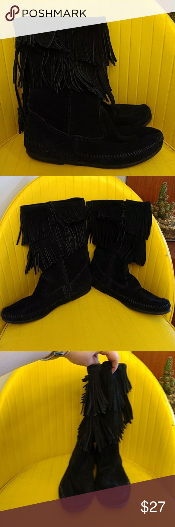 Minnetonka Mid Calf Boots. Black suede leather Minnetonka mid-calf boots. Two tiers of Fringe. Zip up on inside of foot for easy on and off. Lace-up detail on back with tassels. Gently used only worn a handful of times. Size 9. Minnetonka Shoes Moccasins