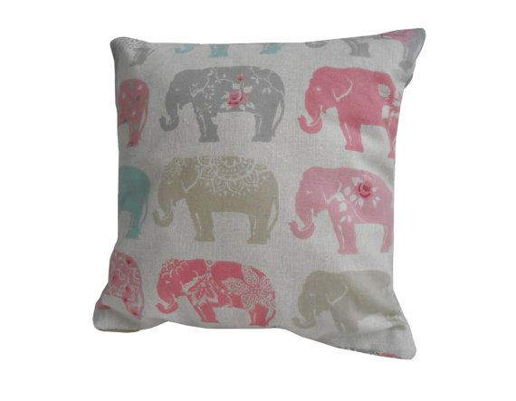 A beautiful two-sided multicoloured cushion cover featuring multi color elephants on a throw pillow of your chosen size.  Pick your desired size