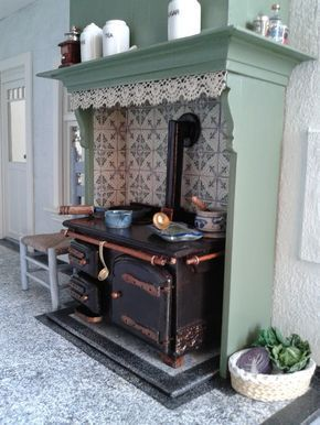 Progress on Miniature House. I made some changes to the fireplace and black cooker. And I constructed and painted a kitchen s...