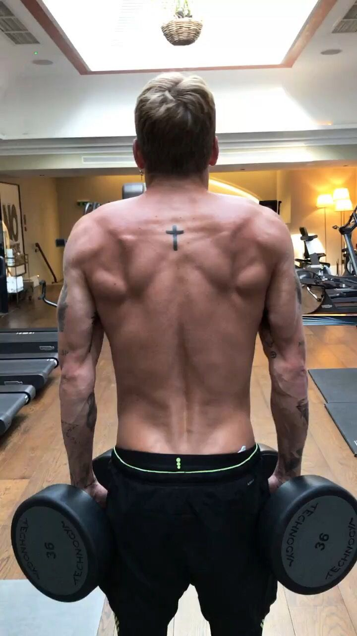 This cross tattoo was the first tattoo I ever got. Representing my faith, and I got it In Bondi ink in Sydney. The tattoos on my triceps are two olive branches, a sign of peace.