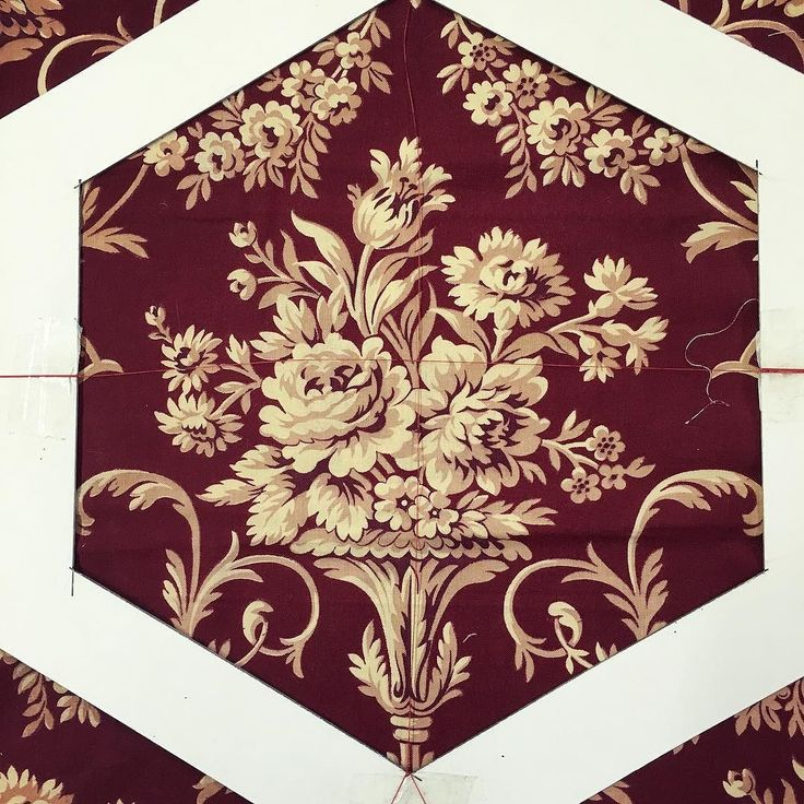 Getting the details right on one of our Vintage Hexagon Sewing Boxes. We use a simple cardboard viewfinder to make sure the box panels look perfect especially when it is antique French fabric like this one. My favorite part is choosing the fabrics and matching up the right braid and tassel colour. #luccellomelbourne #cartonnage #vintagehaberdasheryandfancygoods #etui #artisan #antiquefabric #frenchstyle #aqc #australasianquiltconvention