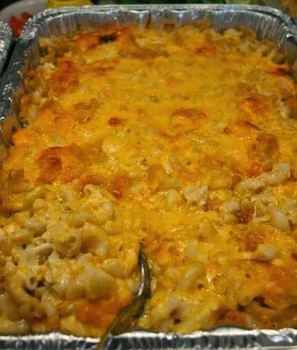 Sweetie Pie's Macaroni & Cheese (serves 12-24)  Ingredients: 1 pound elbow macaroni 1 cup whole milk 2 12-ounce cans evaporated milk 3 eggs 1 cup butter, cut into small pieces ½ pound Colby cheese, grated ½ pound Monterey Jack cheese, grated ½ pound sharp Cheddar cheese, grated 1 pound Velveeta cheese, cut into small chunks ½ cup sour cream Salt, to taste 1 TB white pepper 1 TB sugar 1 cup grated mild Cheddar cheese for the topping