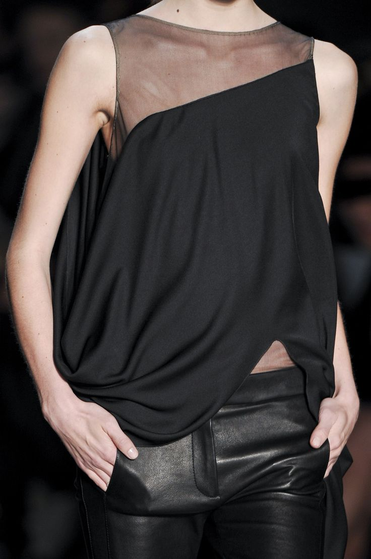 love this look -- asymetrical illusion drapey top with faux leather pants