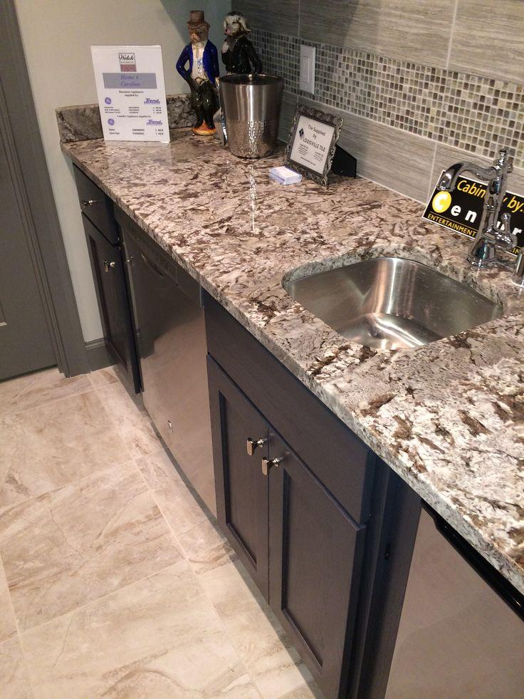 Bianco Antico polished granite counter with dark espresso cabinets. Visit globalgranite.com for your natural stone needs.