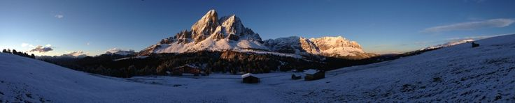 A guide to skiing in the Alta Badia region of the Dolomite Mountains, Italy, a perfect destination for a ski holiday.