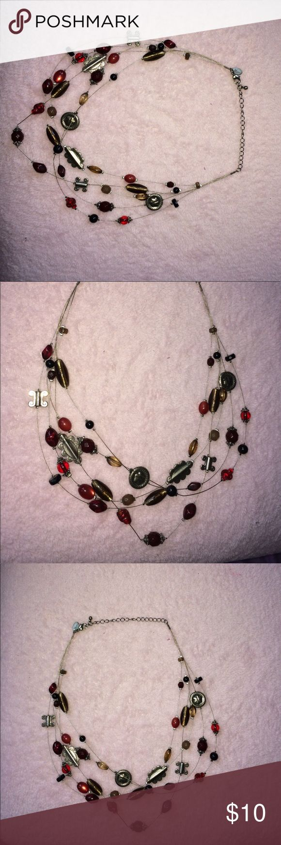 Lia Sophia beaded statement necklace  This necklace is NWOT! It has brown, black, red, and silver beads around a sterling silver necklace! Super cute and versatile Lia Sophia Jewelry Necklaces