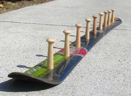 Wooden-Hook-Snow-Ski-Coat-Rack- Could do this with a skate board for my brother