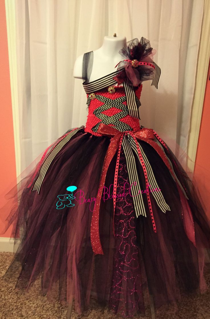 Hot Pink and black tutu Pirate dress with matching headband.